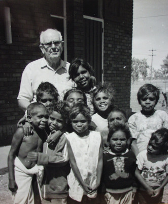 Fr Kevin McKelson with children at LaGrange, 1980